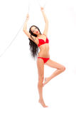 Leggy beauty in red underwear hanging Stock Image