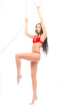 Leggy beauty in red underwear hanging Stock Photography
