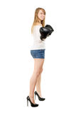 Leggy blond woman. Happy leggy blond woman smiling and posing with boxing gloves Stock Image