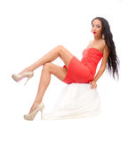 Leggy brunette in a red dress Stock Photo