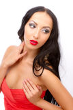Leggy brunette in a red dress Royalty Free Stock Images