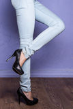 Leggy girl in black shoes with high heels Stock Image
