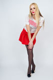 Leggy pretty young blonde girl posing Stock Photos