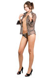 Leggy sexy young woman in leopard shirt Stock Images