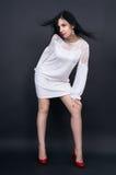 Leggy slender girl in a mini dress posing Royalty Free Stock Image