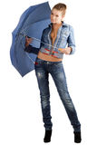 Leggy woman in a denim suit. With umbrella Royalty Free Stock Image