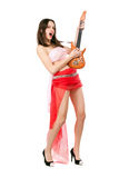 Leggy woman in red skirt. And pink top playing the toy guitar. Isolated on white Royalty Free Stock Photos