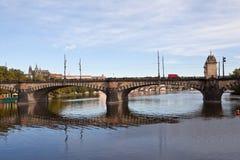 Legia Bridge. Prague. Czech Republic. Prague, Czech Republic - 05 September 2015: Stone Bridge consists of nine low arch spans with turrets and lanterns on Royalty Free Stock Photo