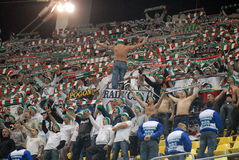Legia Warsaw football fans cheering. For their team during an Europa League game Royalty Free Stock Photo
