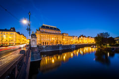 The Legion Bridge and buildings along the Vltava at twilight, in Royalty Free Stock Image