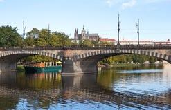 Legion Bridge. Prague. Czech Republic. Prague, Czech Republic - 05 September 2015: Stone Bridge consists of nine low arch spans with turrets and lanterns on Royalty Free Stock Photos
