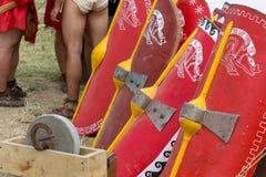 Legionary Shields in a Roman Encampment. Legionary shields between tents in a Roman encampment Royalty Free Stock Photo