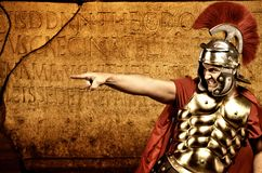 Legionary soldier. In front of roman wall Royalty Free Stock Images