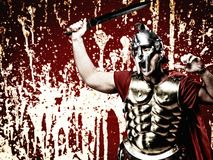 Legionary soldier. Over abstract bloody wall stock image