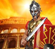 Legionary soldier in front of coliseum. Roman legionary soldier in front of coliseum Royalty Free Stock Image
