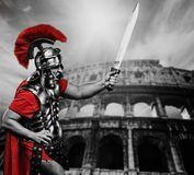 Legionary soldier in front of coliseum Stock Photo