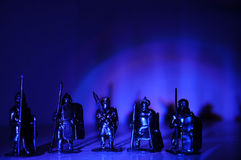 Legionary warrior knight souvenir miniature figurines hand made,arch light dark background. Soldiers toy for boys and mans, tin soldier concept,medieval knights Stock Image