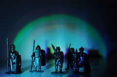 Legionary warrior knight souvenir miniature figurines hand made,arch light dark background,soldiers toy for boys and mans Royalty Free Stock Image