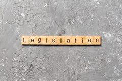 Free Legislation Word Written On Wood Block. Legislation Text On Table, Concept Stock Photos - 185364373