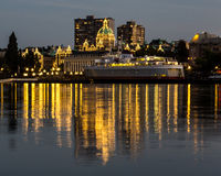 The Legislative Buiding and a Ferry in Victoria at Dusk Royalty Free Stock Photography