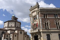 Legnano, Italy: Malinverni Palace and San Magno church. Legnano, Milan, Lombardy, Italy: the historic building known as Palazzo Malinverni, hosting the town hall royalty free stock photography