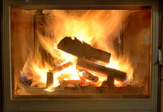 Legno Burning in camino Fotografia Stock