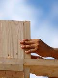 Legno della holding della mano - verticale Immagine Stock Libera da Diritti