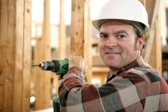 Legno di perforazione del carpentiere Fotografia Stock
