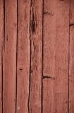 Legno rosso incrinato sbucciando le plance Fotografie Stock Libere da Diritti