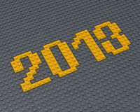 Lego 2013 fonts. Yellow Lego 2013 fonts new year on gray background Stock Photography
