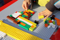 Lego. A child attend a lego contest stock photography