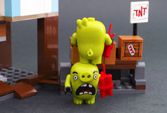 Lego Angry Birds. Two bad piggies getting TNT out of box Stock Image