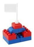 Lego Bausteine mit Markierungsfahne Lizenzfreies Stockfoto