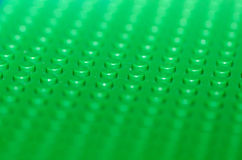 Lego board. Macro close-up of a green Lego board Stock Photography