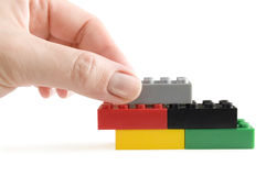 Lego builder in hand Royalty Free Stock Photo