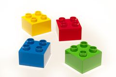 Building blocks isolated. Lego building blocks isolated on white. Four colors - yellow, red, blue and green stock photos