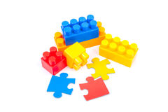Lego cubes and puzzles. On a white background Royalty Free Stock Images