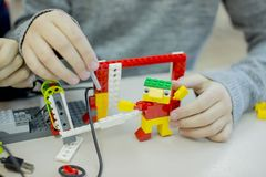 Lego-design circle in high school, children assemble models from the designer royalty free stock image