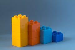 Lego diagram på blå bakgrund Arkivbild