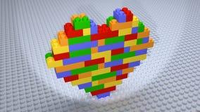 Lego - färgglade hjärtategelstenar som konstrueras på den vita grunden Royaltyfria Bilder