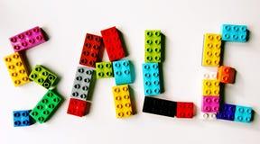 Lego försäljningstecken royaltyfri foto
