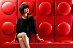 Lego fashion. Asian fashion model on red lego background Royalty Free Stock Photo
