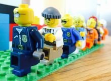 lego figures marching Royalty Free Stock Photo