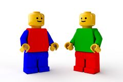 LEGO figures, two toys male characters. Two multi-colored LEGO figures standing opposite each other on a white background royalty free illustration