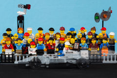 Lego formule 1 race car moving in front of audience Royalty Free Stock Image