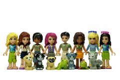 Lego friends with their animals. Lego friends of different nationalities and skin color with their favorite pets. Grooms and girls with dogs, cats, turtle and stock photo
