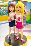 Lego girls. MOSCOW, RUSSIA - DECEMBER 11, 2015: two girls made by Lego blocks in Central Children's Store on Lubyanka stock image