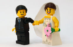 Lego groom leading bride Royalty Free Stock Images