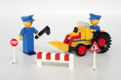 Lego Maxifig Building non ha messo 214, squadra della riparazione della strada Fotografia Stock