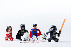 LEGO minifigure Batman, Superman, Stormtrooper and darth vader. Royalty Free Stock Photo